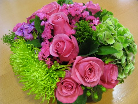 Which flowers would be best for a ladies luncheon first come flowers arrangement a hot pink roses green spider mum pink phlox green hypericum berries hydrangea and trachellium mightylinksfo