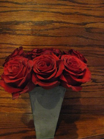 Red Roses in Rustic Vase