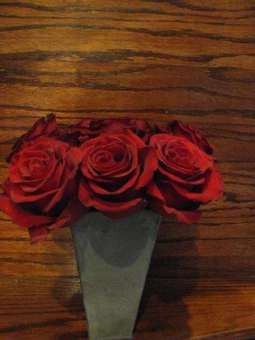 Red Roses in Rustic Vase