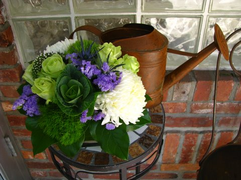 Purple and Green Flowers Rusty Watering Can