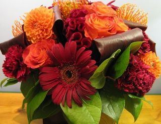 Red Dk Gerbera and orange Arrangement