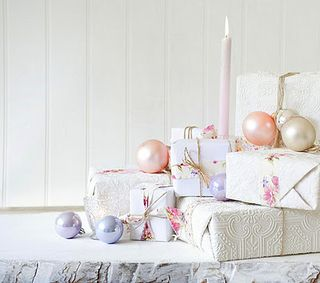 White packages with pink ribbon